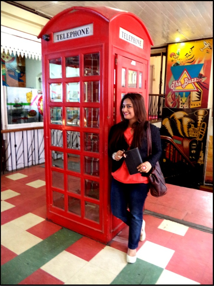 Posing at the Phone Booth inside Glenary's