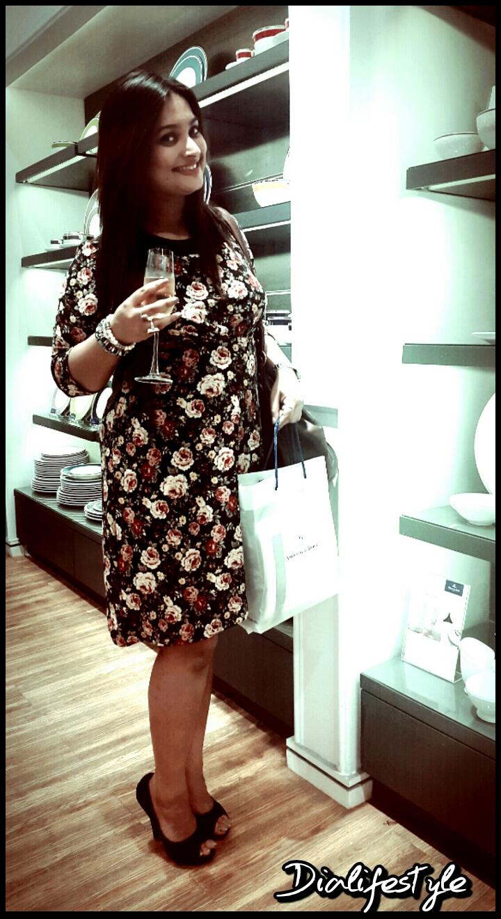 I'm wearing: Black floral dress: 10 Black pumps: Thrifted
