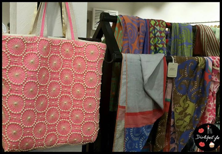 "Bags on walls and scarves on ""Alna"", an antique furniture from Bengal"